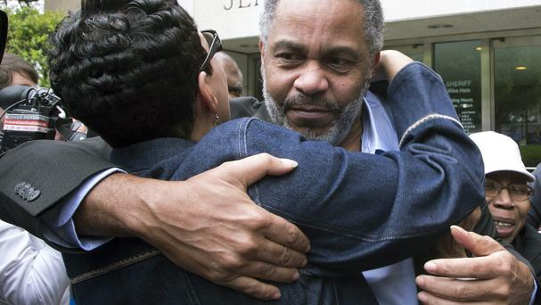 Pat Turner hugs Ray Hinton, facing, who was set free after spending nearly 30 years on death row in Alabama (AP)