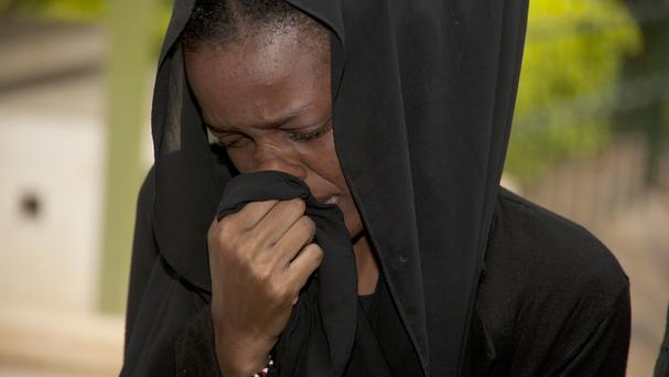 A weeping relative reacts after viewing the body of a family member killed in Thursday's attack on the university on Kenya (AP)