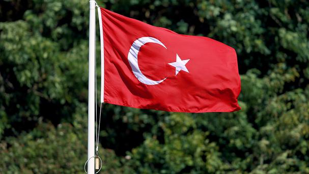 A coach carrying a football team has been attacked in Turkey