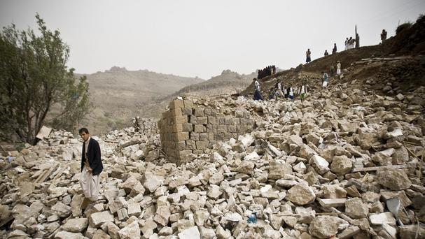 Yemenis search for survivors in the rubble of houses destroyed by Saudi-led airstrikes in a village near Sanaa (AP)