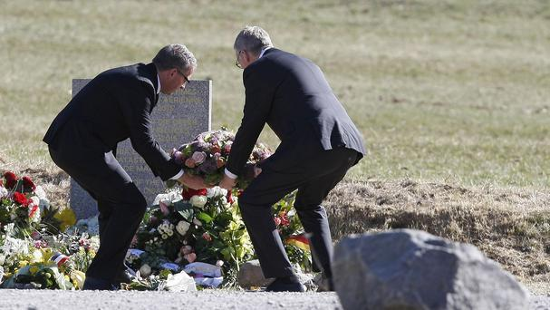 Chief executive of Germanwings Thomas Winkelmann and Lufthansa chief executive Carsten Spohr, left, lay a wreath in memory of the victims (AP)