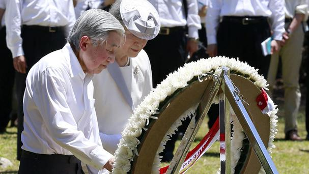 Japan's Emperor Akihito and Empress Michiko lay a wreath in front of a memorial for American victims on Pelelilu island in Palau (Kyodo News/AP)