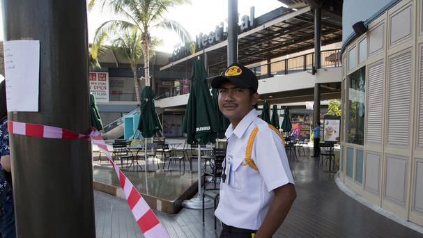 A security guard stands outside the closed Central Festival mall on Samui Island. (AP)