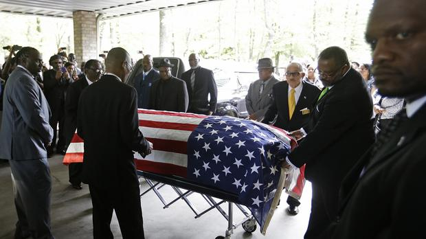 The casket of Walter Scott is wheeled into WORD Ministries Christian Centre in Summerville, South Carolina (AP)