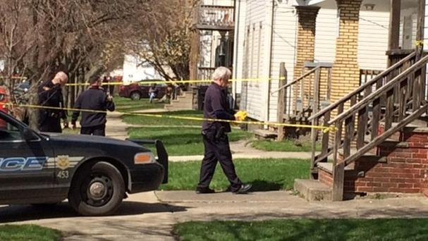 Police at the scene of the shooting involving two children in Cleveland, Ohio (Northeast Ohio Media Group/AP)