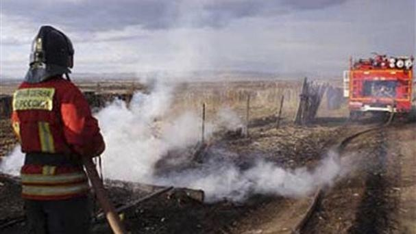 A firefighter extinguishes a fire in Khakassia, a region in south-eastern Siberia, Russia (Ministry for Emergency Situations, Khakassia branch in Siberia via AP)
