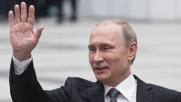 Russian President Vladimir Putin says he welcomes opposition participation in elections (AP)