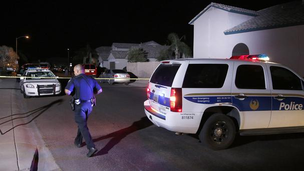 Phoenix police near the home where five people were killed in a shooting (AP)