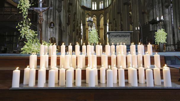 Candles are placed in Cologne Cathedral as a service was held in memory of the victims of the Germanwings plane crash (AP)