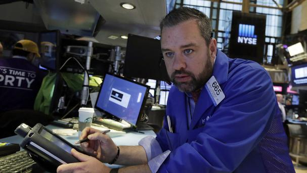 Trader Kevin Lodewick works on the floor of the New York Stock Exchange (AP)