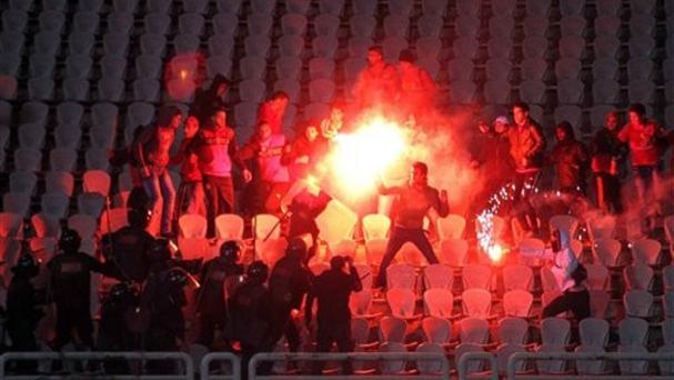 Fans clashed with riot police at the football stadium in Port Said, Egypt. (AP)