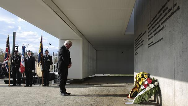 German foreign minister Frank-Walter Steinmeier attends a wreath laying ceremony at the Nazi concentration camp Sachsenhausen in Oranienburg, north of Berlin (AP)