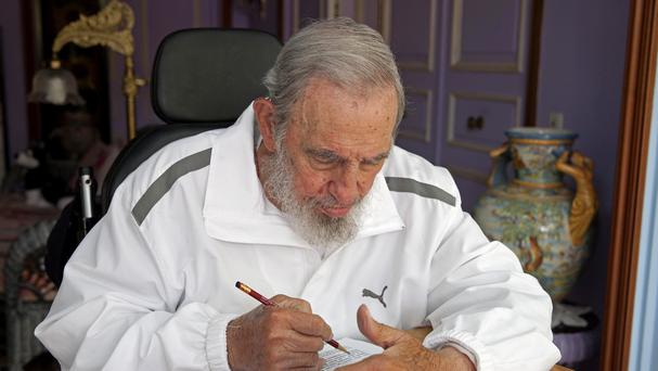 Fidel Castro votes in municipal elections at his house in Havana (AP)