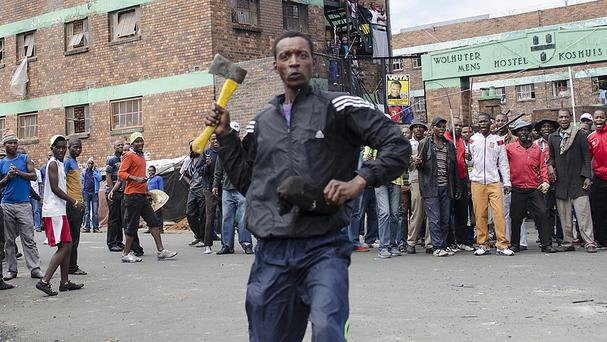 Shops and cars have been torched in continued anti-immigrant attacks by locals in Johannesburg. (AP)