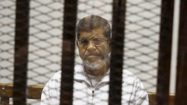 An Egyptian criminal court sentenced Morsi to 20 years in prison over the killing of protesters in 2012 (AP)