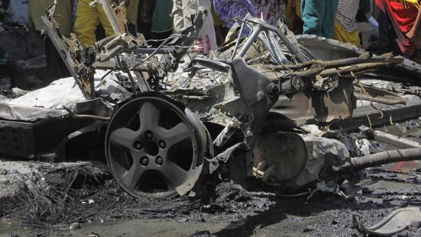 The wreckage of car bomb which exploded outside a restaurant in Mogadishu, Somalia. (AP)