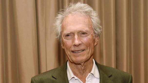 Clint Eastwood has denied threatening to kill outspoken film-maker Michael Moore (Invision/AP)