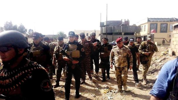 Iraqi security forces and tribal fighters regain control of al-Warrar and Haouz neighborhoods in central and South Ramadi, 70 miles west of Baghdad (AP)