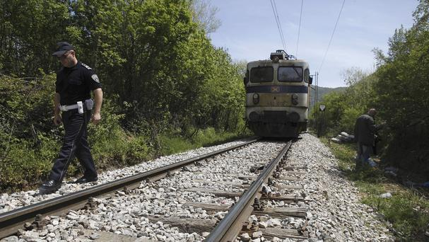 Police check the rail tracks north of the central Macedonian town of Veles after 14 migrants were killed by a train. (AP)