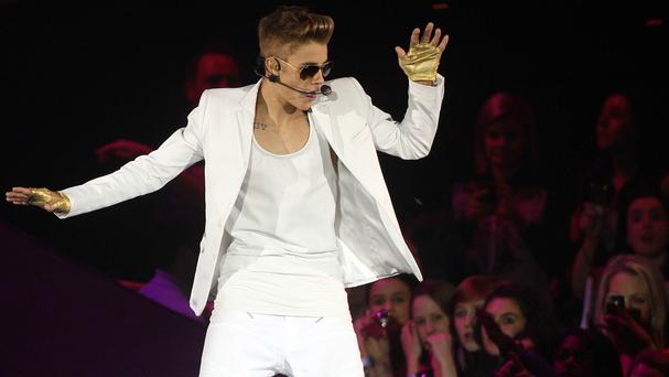 Justin Bieber has reached a settlement