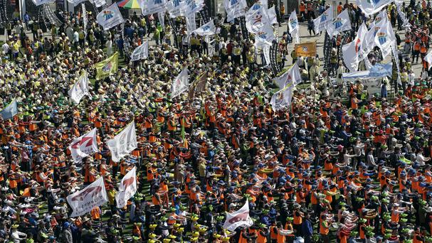 Trade union members take part in a rally against the government in front of Seoul City Hall (AP)