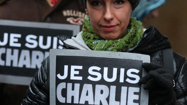 Members of the public show solidarity for Charlie Hebdo in the wake of the France terror attacks