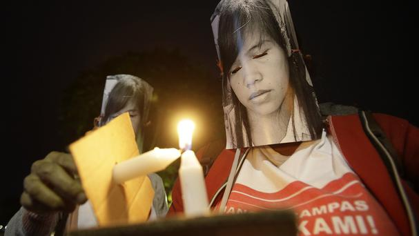 Protesters wearing masks of convicted Filipino Mary Jane Veloso attend a demonstration, demanding the government to stop her execution (AP)