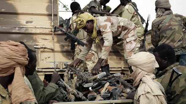 Chadian soldiers collect weapons seized from Boko Haram fighters in the Nigerian city of Damasak (AP)