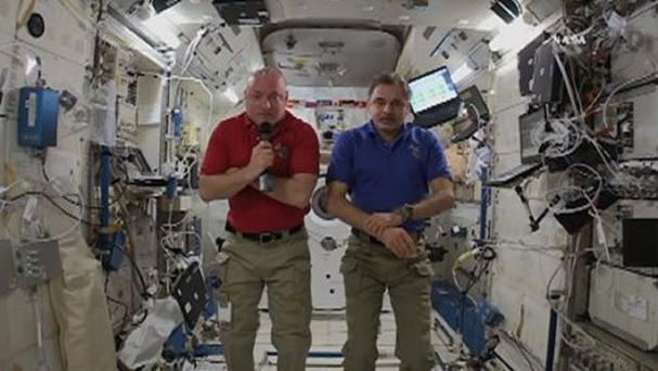 American astronaut Scott Kelly and Russian cosmonaut Mikhail Kornienko are interviewed at the International Space Station (Nasa via AP)