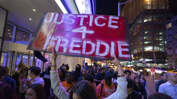 Protesters in Manhattan mark the death of Freddie Gray, a Baltimore man who was critically injured in police custody (AP)