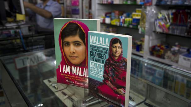 Books about Malala Yousafzai, who survived a Taliban attack, are displayed at a book shop in Islamabad, Pakistan, as 10 militants were jailed for the attack (AP)