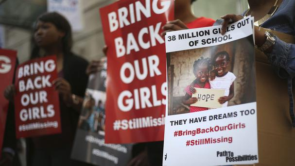 Protesters outside Nigeria House in London demonstrating for the girls abducted by Boko Haram one year ago in Nigeria.