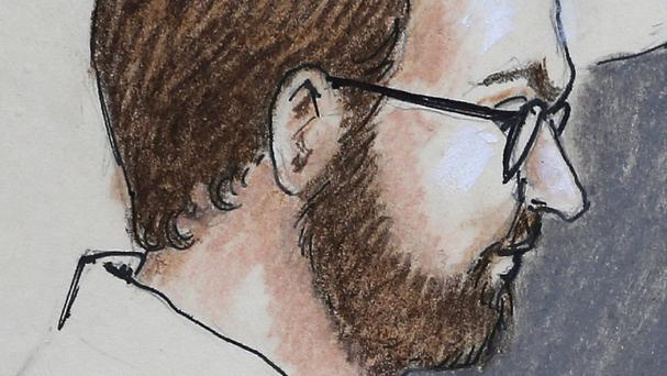 Defendant James Holmes is depicted as he sits in court (AP/Jeff Kandyba)