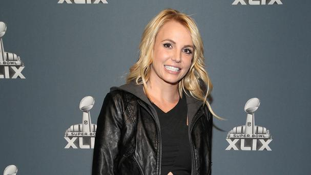 Britney Spears has been forced to postpone two Las Vegas shows after falling onstage (AP)