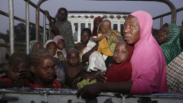 Women and children rescued by Nigerian soldiers from Islamist extremists at Sambisa forest sit in back of a truck in Yola, Nigeria (AP)