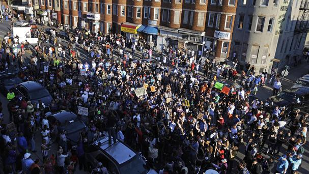 The street party in Baltimore the day after charges were announced against the police officers involved in Freddie Gray's death (AP)