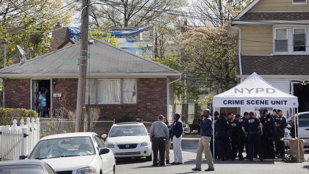 Police officers investigate the scene of a shooting in the Queens borough of New York (AP)