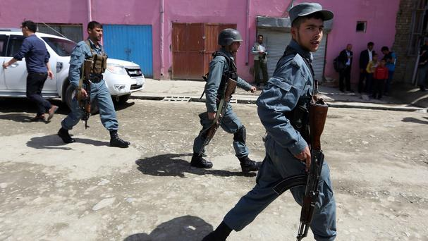 Taliban attacks on police checkpoints in a remote north-western province have killed at least 16 policemen (AP)