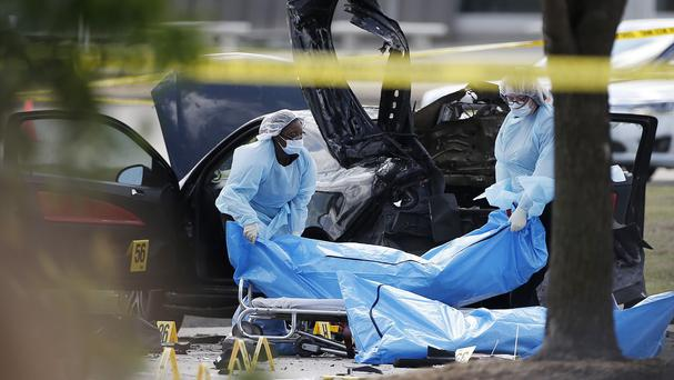 The bodies of the two gunmen are removed from the shooting scene in Garland, Texas (AP)