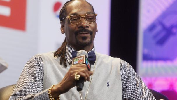 Texas' top law enforcement officer called Snoop Dogg, pictured, a 'dope smoking cop hater' after a state trooper posed for a picture with the rapper (Invision/AP)