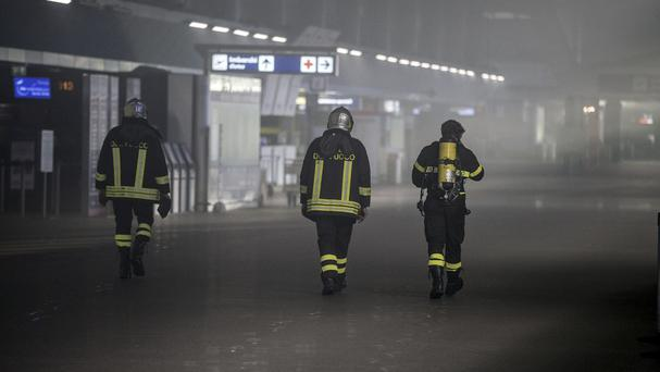 Firefighters inspect Rome's Fiumicino airport after a fire in about 400 square meters of retail space (ANSA via AP)