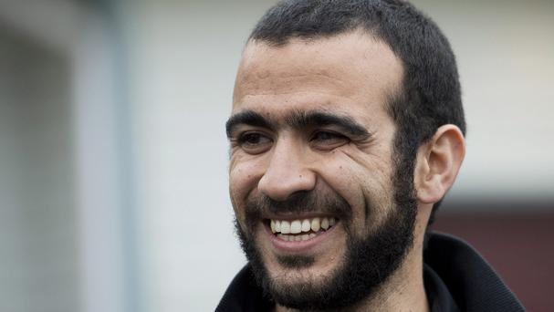 A smiling Omar Khadr speaks outside his lawyer Dennis Edney's home in Edmonton, Alberta (The Canadian Press/ AP)