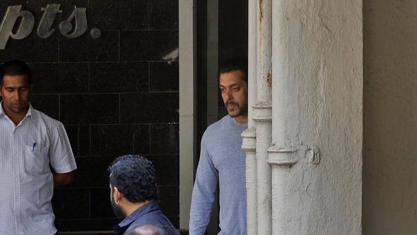 Bollywood actor Salman Khan (centre) has been granted bail pending an appeal over a drink-drive hit-and-run conviction (AP Photo/Rajanish Kakade)