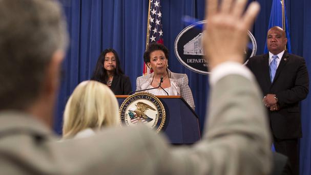 Attorney general Loretta Lynch, centre, announces the Justice Department investigation into Baltimore police department. (AP)