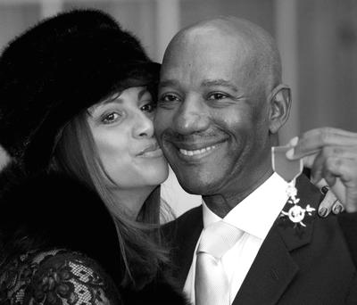 ACCLAIM: Errol Brown, with his wife Ginette, having received his MBE,