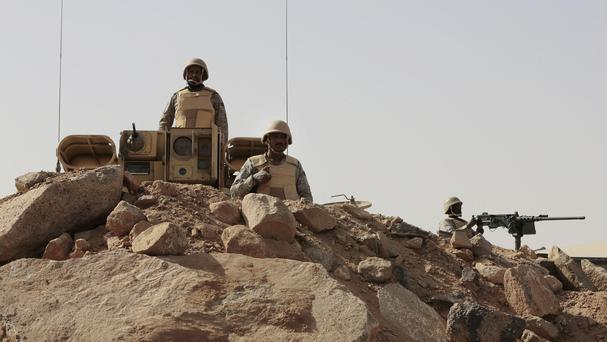 Saudi soldiers stand on top of armoured vehicles, on the border with Yemen at a military point in Najran. (AP)