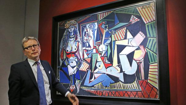 Auctioneer Jussi Pylkkanen with Pablo Picasso's Women Of Algiers (Version O) (AP)