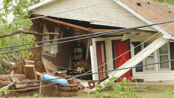 A home in Van, Texas, with an X showing it had been searched by emergency personnel (AP)