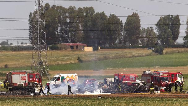 Emergency services at the scene after a plane crash near Seville airport in Spain (AP Photo/Miguel Angel Morenatti, File)