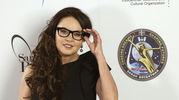Sarah Brightman has postponed her trip to the International Space Station